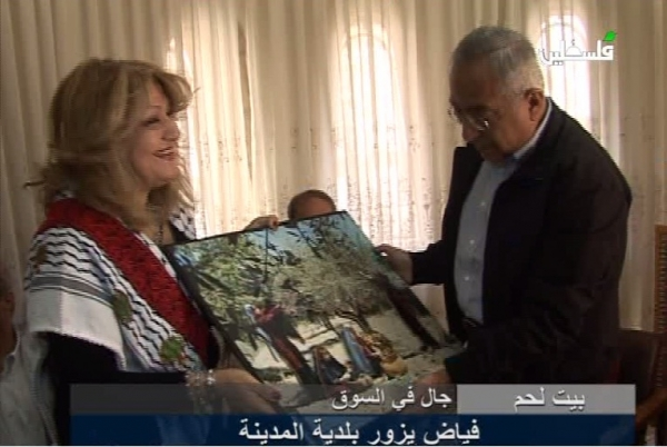 Maha saca was delighted to present a gift to PM Dr. salam Fayyad